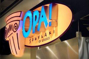Lit Storefront Sign OPA! Restaurant